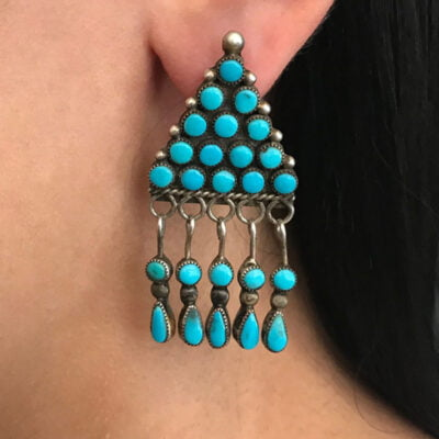 The Beautiful Navajo Turquoise Earrings are a  design for rain clouds.  They are beautifully crafted with consistent Sleeping Beauty Turquoise.
